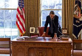 obama at desk public domain image president barack obama standing at his desk and
