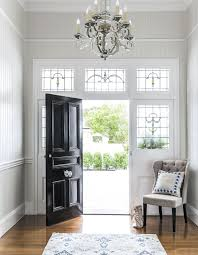 entryway black front door stained glass windows pale grey
