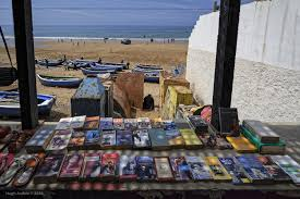 hughes photo beach books and sandals taghazout