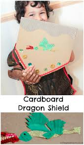 cardboard dragon shield craft in the playroom