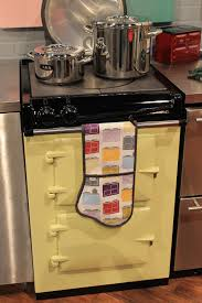 aga colorful ranges and a retro kitchen at kbis retro renovation