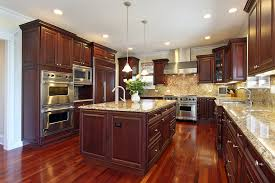grey hardwood floors accent a modern kitchen with cherry cabinets
