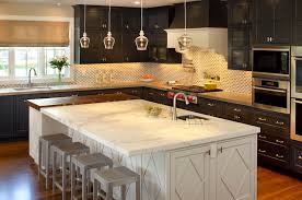 kitchen with black island and white cabinets black perimeter cabinets and white kitchen island
