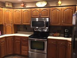 what color countertops go with cabinets golden oak cabinets are unfortunately staying but what