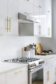 gloss white kitchen cabinets creating a dining area in a terrace