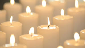 edited of white candles burning with bright flames