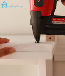 How To Cut Crown Molding Angles For Kitchen Cabinets by Remodelando La Casa Adding Crown Molding To The Top Of Bookcases