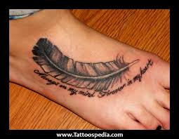 feather with quote on ankle