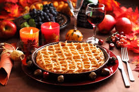 apple pie for thanksgiving with wine and grapes stock photo