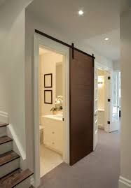 Smallest Powder Room - how to expand small spaces with sliding doors rw hardware