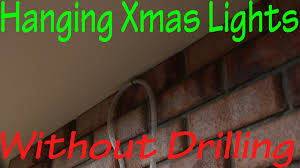 hanging christmas lights without drilling in to bricks youtube