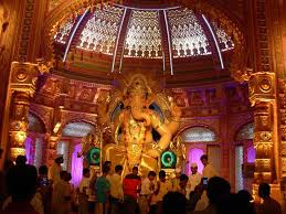 a 12 ft idol of lord ganesha using gold and wearing gold