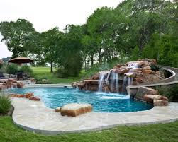 texas custom moss rock waterfall with beautiful water slide