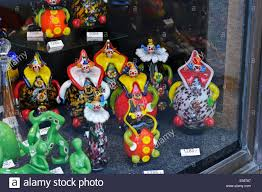 a collection of colourful clown ornaments for sale on display in a