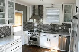 Interior Grey Glass Backsplashes For Kitchens With Brown Wall - Stainless steel cooktop backsplash