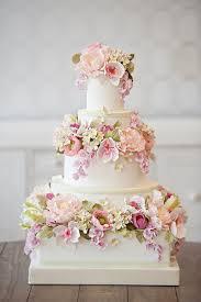 flower laden 3 tiered wedding cake http weddingmusicproject