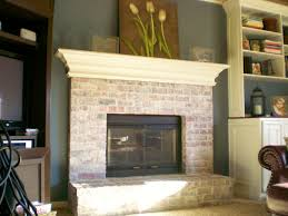 interior white washed brick whitewashing brick fireplace
