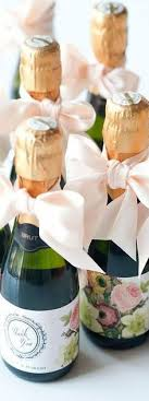 bridal brunch favors mini chagne bottles with straws for getting ready on the