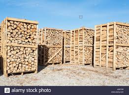 chipped fire wood in packing on pallets stock photo royalty free