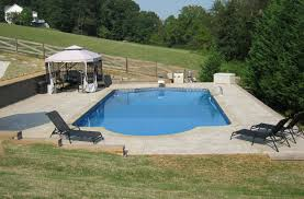 Stamped Concrete Backyard Ideas by Roman With Double Retaining Walls Brick Coping And Stamped