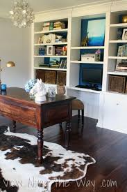Cowhide Rug In Living Room On Using A Real Or Faux Cowhide Rug In A Home Office