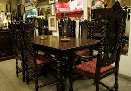 80 90y o carved walnut jacobean dining room set with 6 cane back