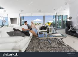 young couple room young couple relaxing on couch luxury stock photo 133991948