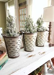 decorating with charlie brown christmas trees and olive buckets