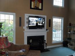 black tv above the fireplace with white frame placed on the brown