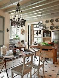 french kitchen design with wooden island table and hanging pot