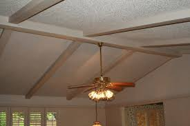romance renovations painting ceiling beams to look like wood
