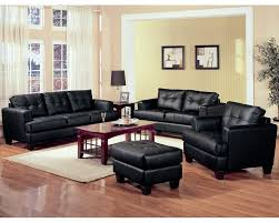 red livingroom luxurious cozy black leather sofa design in stunning peach colored