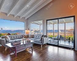 living room corner with large grey sofa beautiful hardwood floor