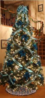 beautiful tree decorating with cross ribbon decorating