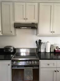 light gray kitchen cabinets with granite what backsplash with light gray cabinets and black granite