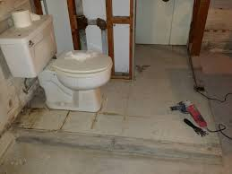 can i break up the floor of a raised floor basement bathroom
