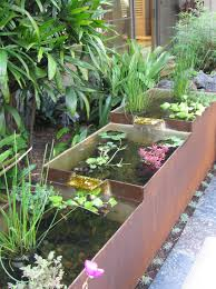 weathered steel fountains troughs and shade sails u2013 how cool can