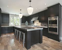 kitchen ideas with black cabinets cabinets grey countertops and light wood floors for the