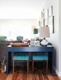 benches under console table behind the sectional brilliant can