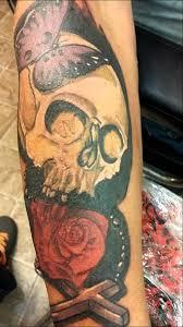 tattoos by tim g skull butterfly cross