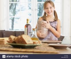 young in dining room setting table stock photo royalty free
