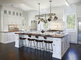 white kitchens with islands white kitchen with island butcher block dining table pendant light