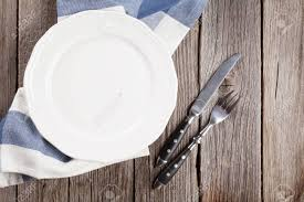 plate table top empty plate and silverware on wooden table top view stock photo