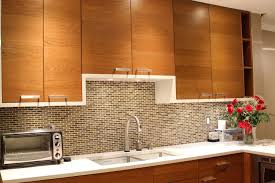 kitchen cherry color cabinets glass subway tile kitchen