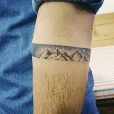 dotwork style mountain armband artist doy tattoos