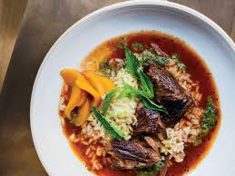 red wine braised lamb with saffron rice mint pistou and pickled