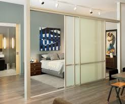 bedroom sliding doors separation with sliding glass doors and rail lighting for the