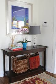 Small Entryway Table by Lovely Ideas With Blue Pattern Curtain Window Beside Nice Artwork