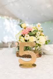 gold wedding table numbers number five at the table gold wedding table number foto royalty