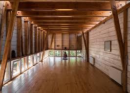 wood studio dx arquitectos adds black wood studio to s house